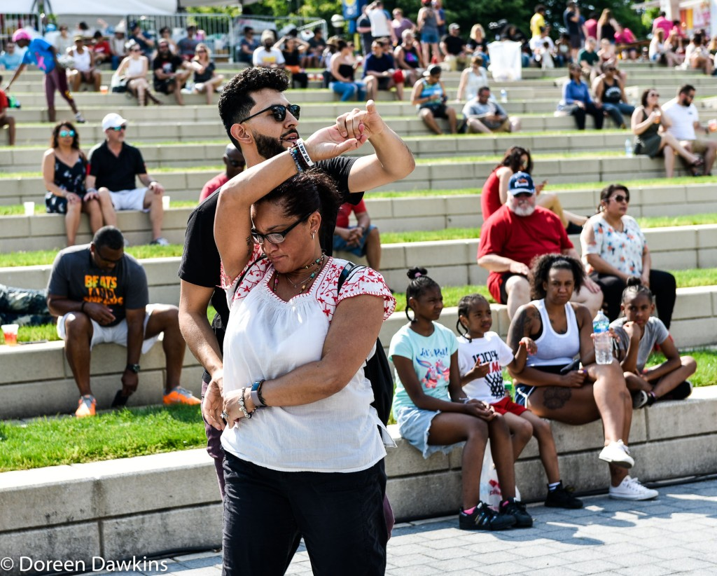 Couple dancing in the moment at the Columbus Taco Fest