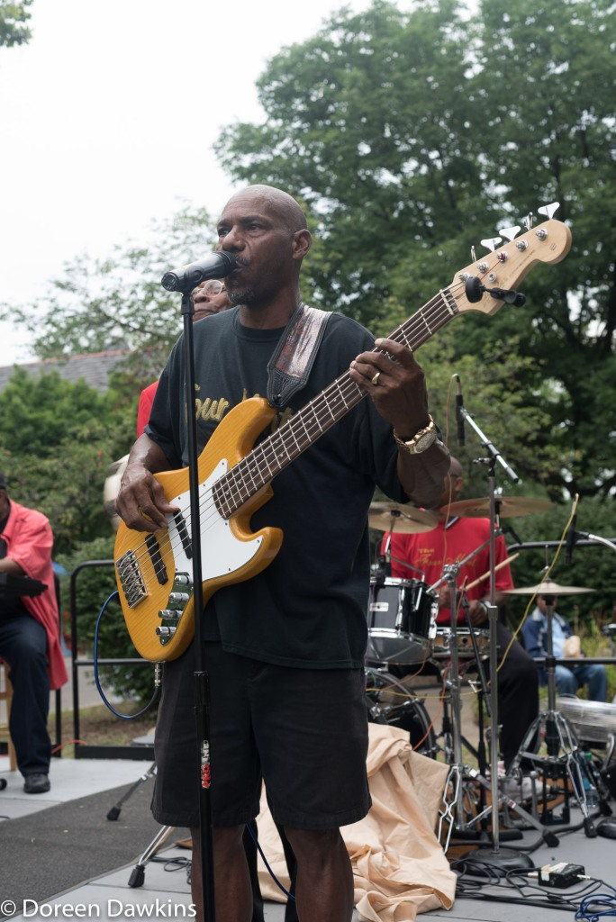 """Ron Henderson performing the whistle part of """"Sitting on the Dock of the Bay"""", with the Four Mints at the Cultural Wall Music Festival"""