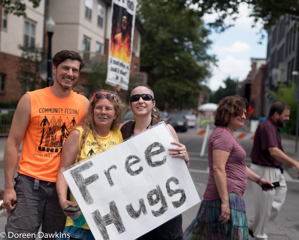 The showdown: free hugs vs fire and brimstone. Comfest