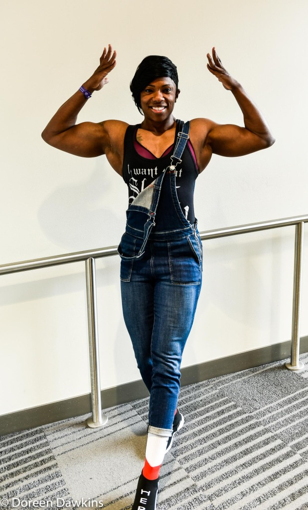 Sammica Cash (IFBB Pro in women's physique, front double bicep pose), Arnold Sports Festival USA 2019: A Splash of Color