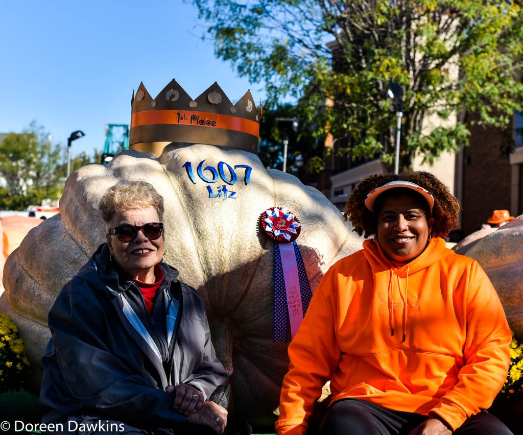 Doreen Dawkins and Marilyn Dawkins in front of the prize pumpkins Circleville Pumpkin Show 2018, That's a big pumpkin!
