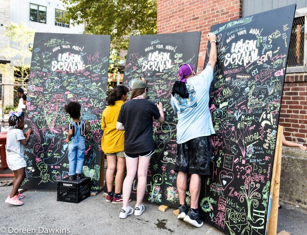 Signing the board at Urban Scrawl 2019