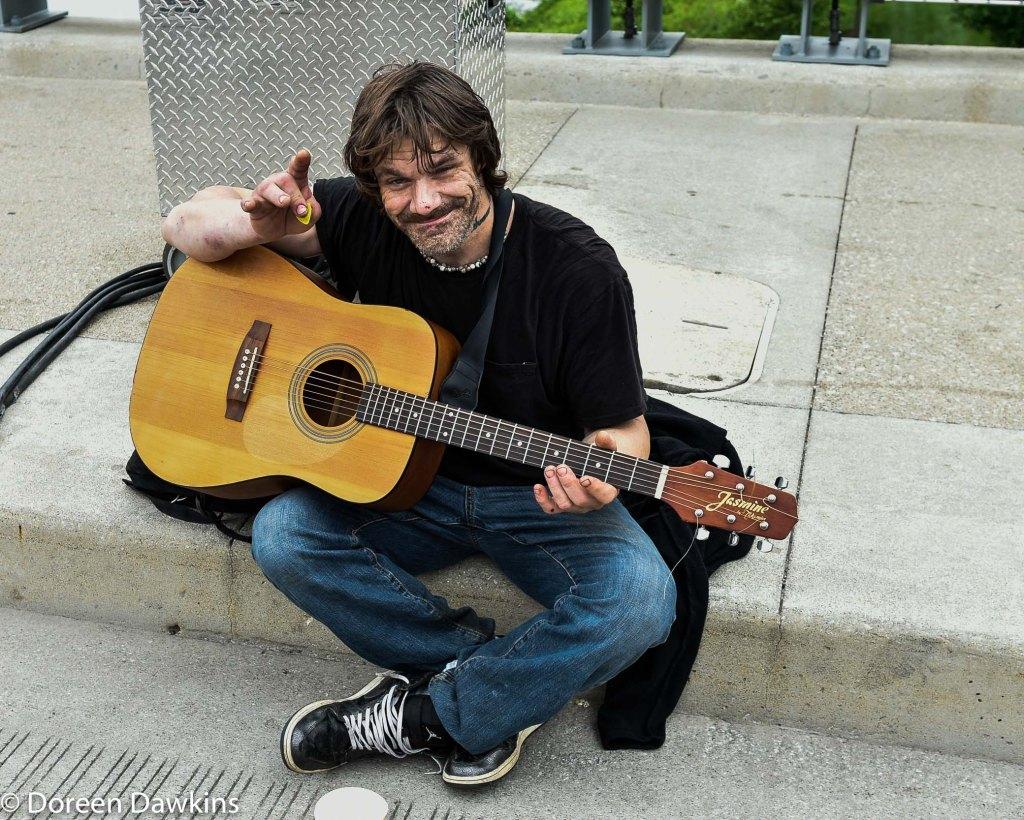 Playing the guitar Street musician, Columbus Arts Festival 2019