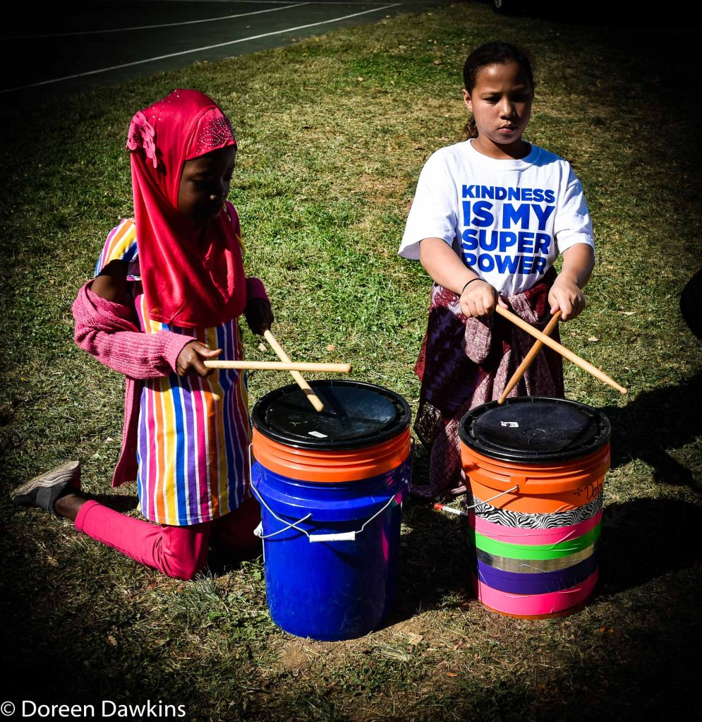 Playing the drums at the  Harmony Project at Sullivant Gardens Community  Center