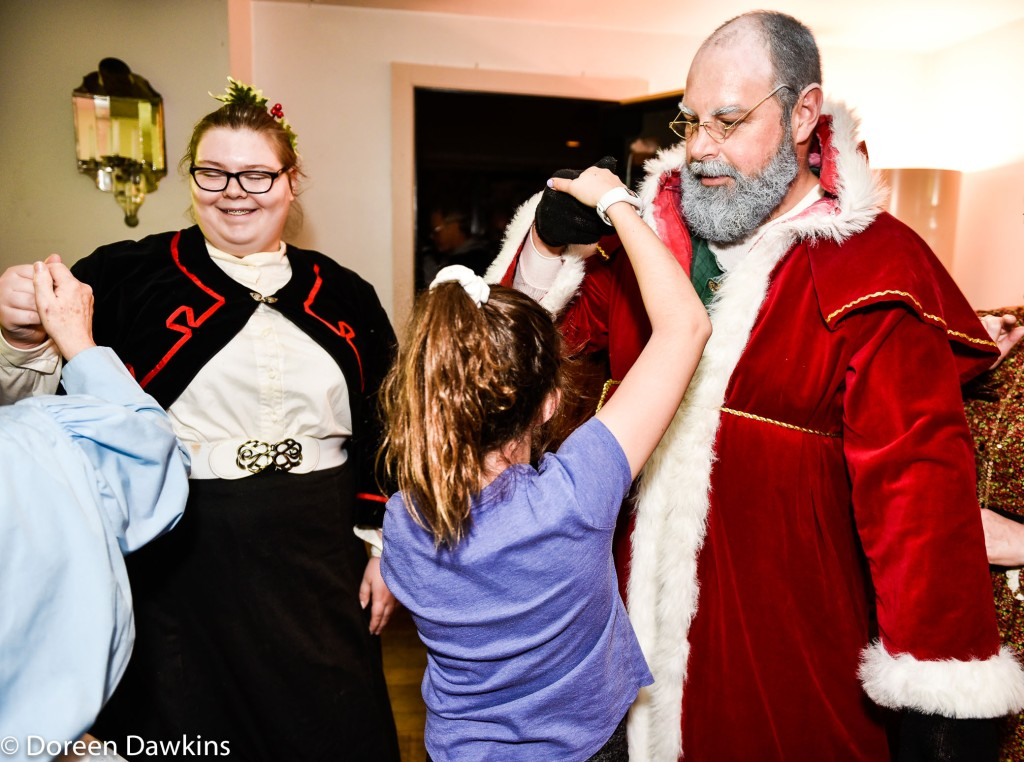 Santa Claus, Victorian style, doing the Patty Cake Polka, Dickens of a Christmas