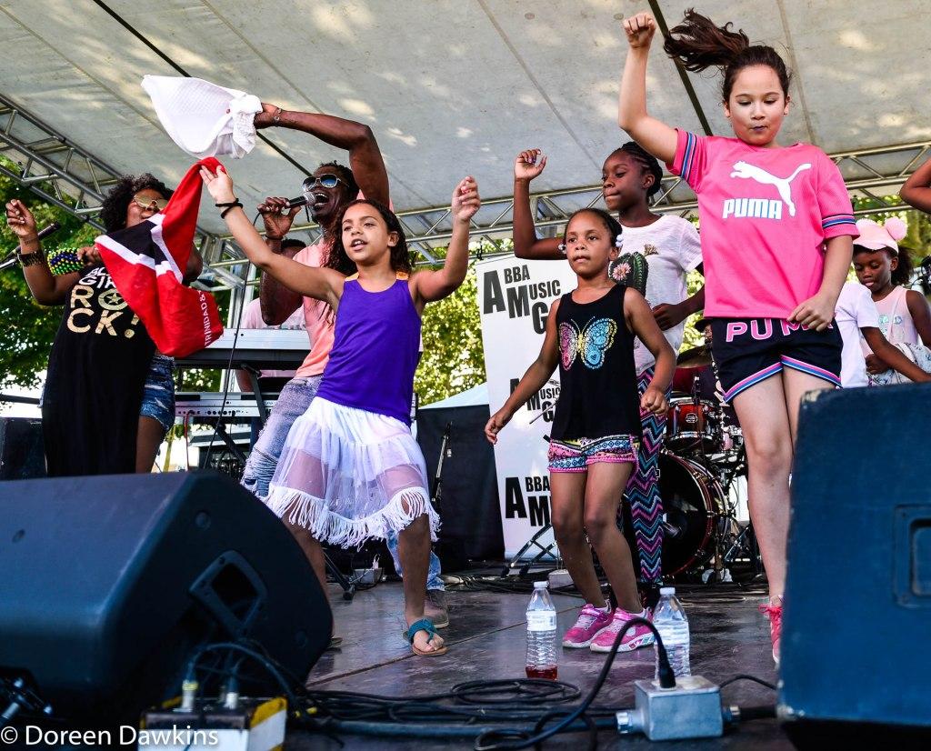 Stedic and children dancing at the Columbus Caribbean Festival 2019