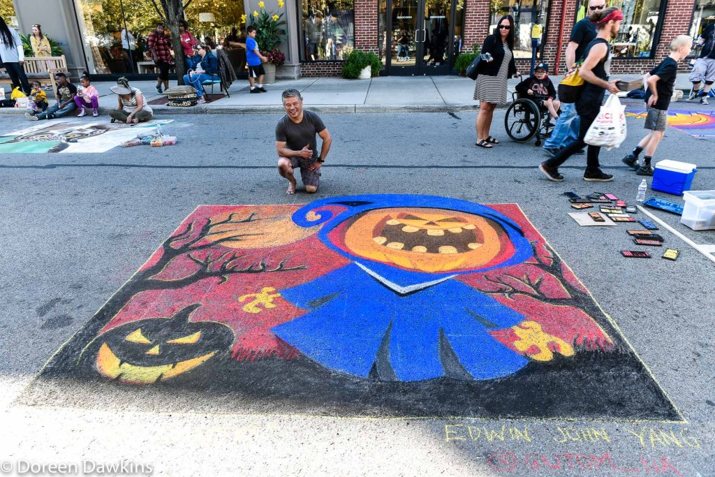 "Artist Edwin John Yang, ""Jack-'o-lantern asking for candy"", Chalk the Block 2019"