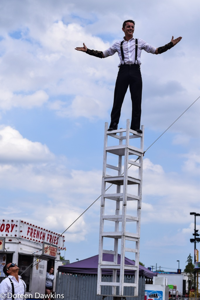 Balancing on chairs. Flippin' – The Aerial and Acrobatic Spectacular, Ohio State Fair 2019