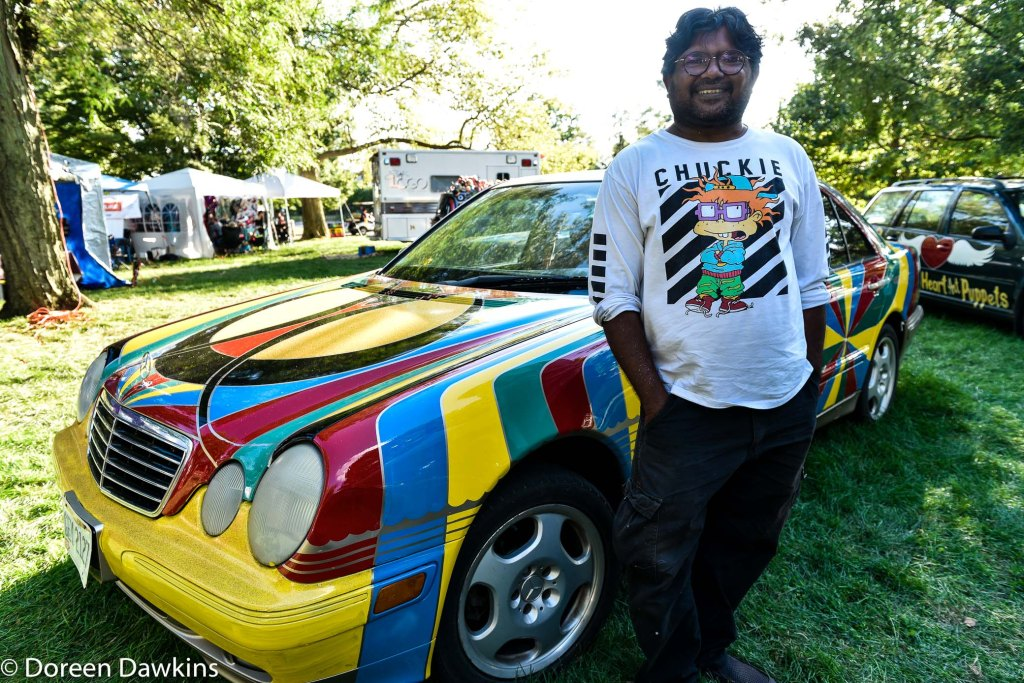 Artist Haider Ali painting an art car at Hot Times Festival 2019