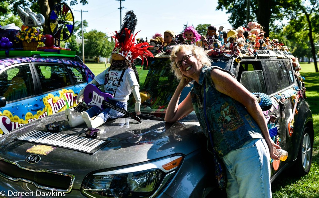 Suzie Simpson and her art car, Summer Jam West 2019