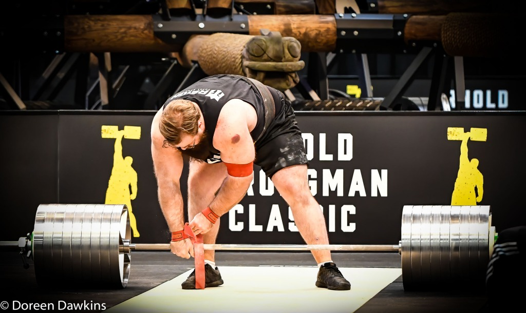 Pro Strongman Bobby Thompson strapping in at the Arnold Sports Festival 2020: Arnold Strongman Classic Elephant bar deadlift