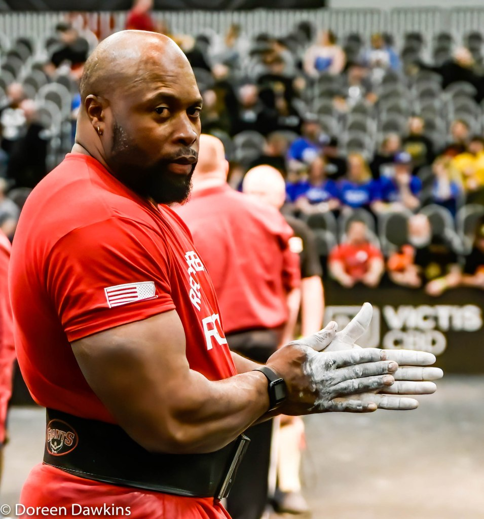 Mark Felix preparing for the Dinnie Stone Hold at the Arnold Sports Festival 2020