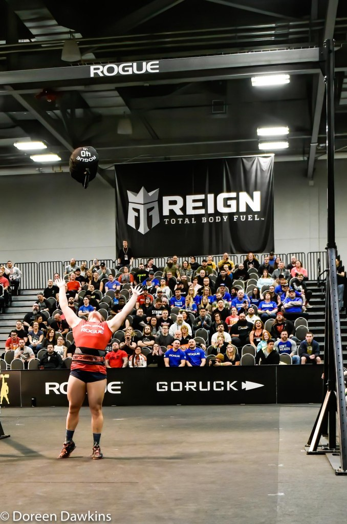 Strongwoman Hannah Linzay celebrating after setting a world record for the sandbag throw over a 15 feet bar, Arnold Sports Festival 2020
