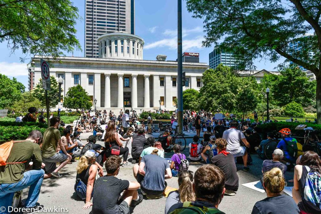 Taking a knee on the way to the Ohio Statehouse protest, COVID-19 Break: Black Lives Matter Protest- Columbus